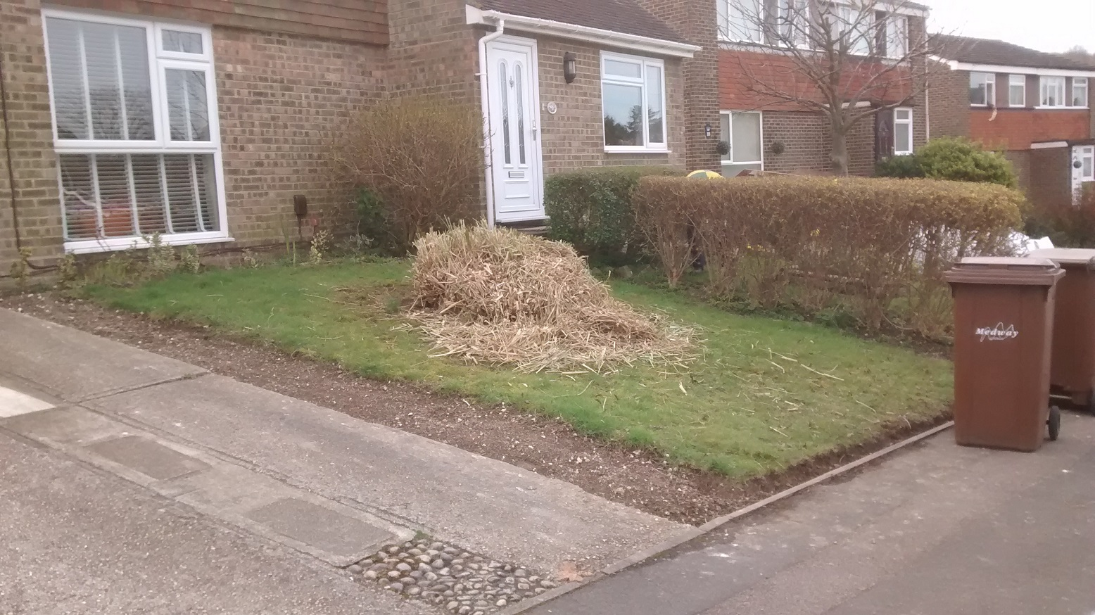 Sloping front lawn and tired old grass