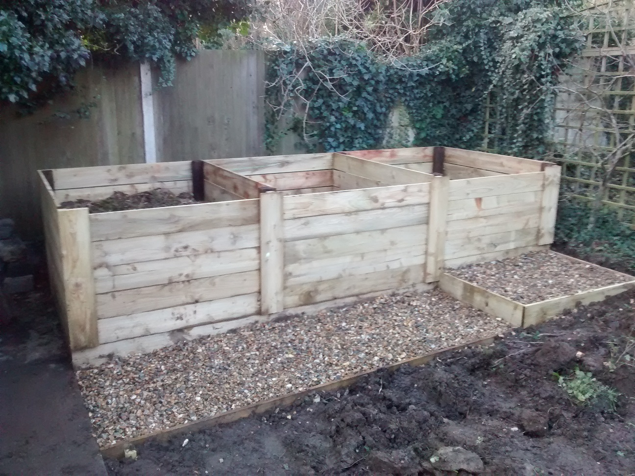 3 compost bins and path